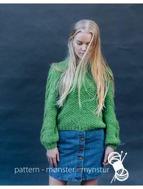 Sweater med mønster på ærmerne